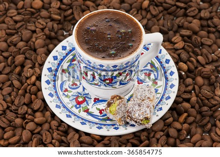 Turkish coffee and coffee beans and turkish delight - stock photo