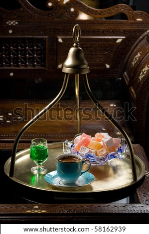 turkish coffee on a tray with turkish delight and liqueur - stock photo