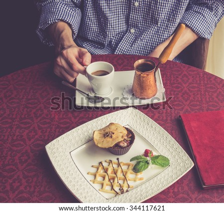 Turkish coffee serve and dessert on the table - stock photo