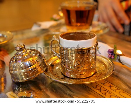 Turkish coffee served in a traditional Turkish metal dish cap