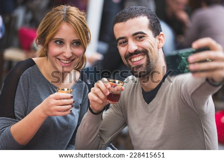 Turkish Couple Taking Selfie while Drinking Cay, Traditional Tea - stock photo