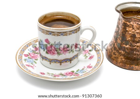Turkish cup of coffee with pot on white - stock photo