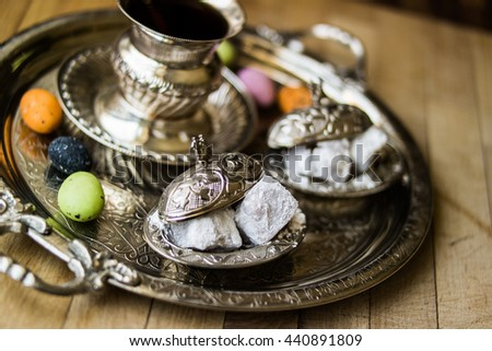 Turkish delight lokum with tea in a silver tray