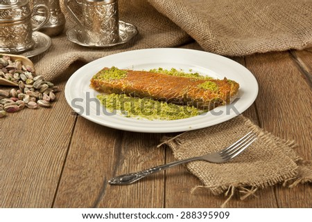 Turkish dessert kadayif kunefe with pistachios - stock photo