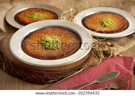Turkish dessert kunefe with pistachio powder - stock photo