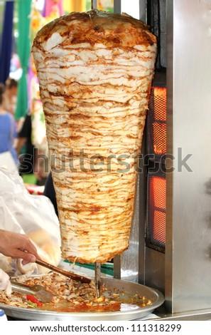 Turkish doner kebab in a restaurant in istanbul . ( chicken doner kebab ) - stock photo