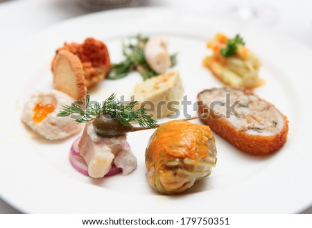 Turkish fish snack on plate, close-up - stock photo