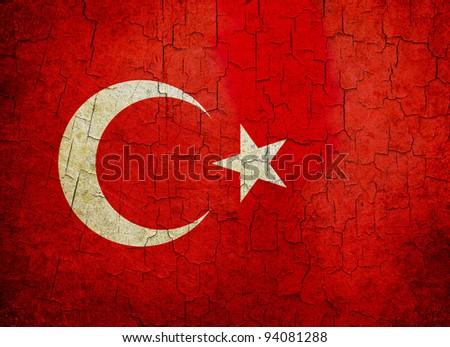 Turkish flag on a cracked grunge background - stock photo