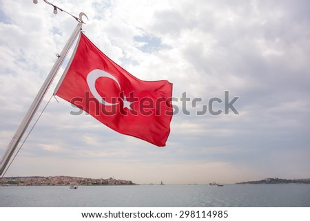 Turkish flag on the back of a passanger boat in the Bosphorus Strait in Istanbul Turkey - stock photo