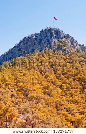 Turkish flag on top of a mountain near Kemer - stock photo