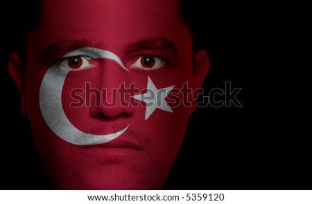 Turkish flag painted/projected onto a man's face.
