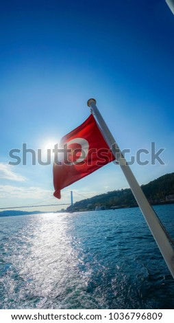 Turkish Flag Waving In The Blue Sky