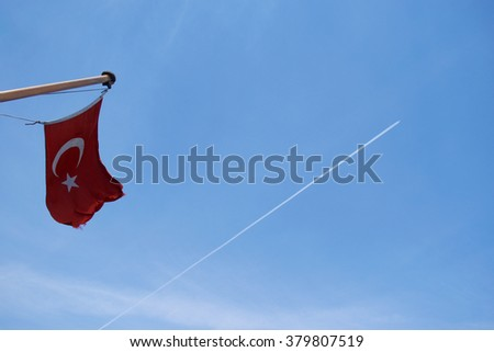 Turkish flag with plane and contrail