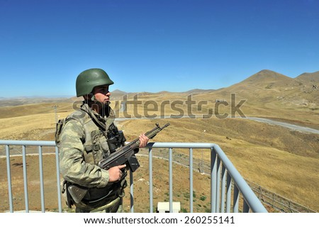 TURKISH-I RAN  BORDER - AUGUST 30, 2011: Unidentified Turkish soldier guard along the border on August 30, 2011