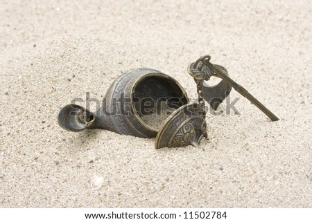 turkish lamp laying on desert sand - stock photo