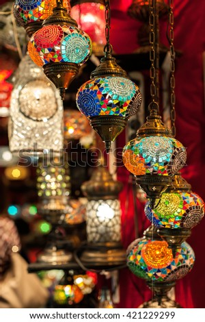 Turkish lamps for sale in the Grand Bazaar, Istanbul, Turkey. Vertical shot. Shallow DOF, focus is on the lamp in the middle. - stock photo
