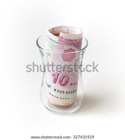 Turkish Lira banknotes in the glasses - stock photo