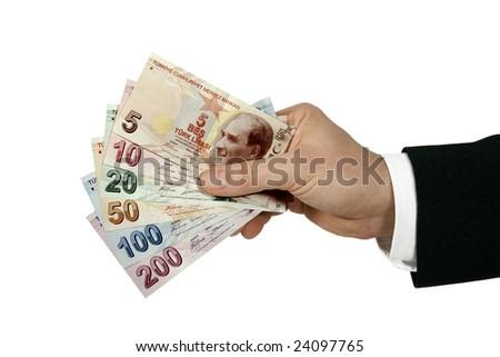 turkish lira in businessman's hand - stock photo