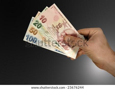 Turkish lira in hand - stock photo