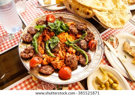 Turkish lunch of meatball kofta, peppers and coos coos bulgar in  Ankara, Turkey