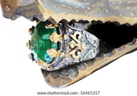 Turkish Ottoman ring with emerald in gold and silver setting - stock photo