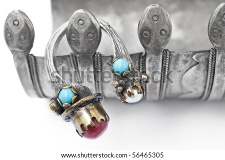Turkish Ottoman ring with pearl and ruby on the antique snake bracelet - stock photo