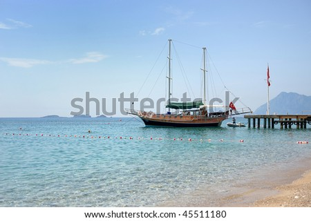 Turkish seascape with a beautiful boat and a flag
