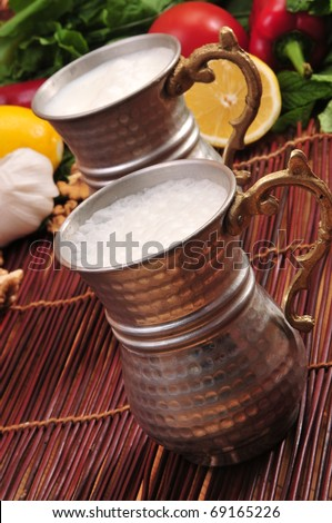 turkish serve drink ayran in copper cup - stock photo