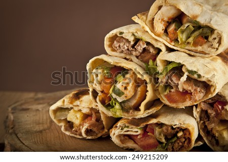 Turkish Shawarma durum Traditional sish kebab wrap - stock photo