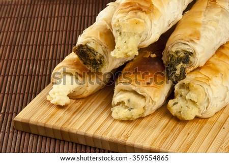 Turkish style meat stuffed filo dough rolls served - stock photo