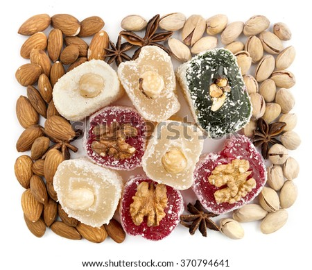 Turkish sweets, almonds, pistachios and spices background
