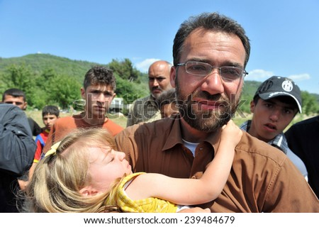 TURKISH-SYRIAN BORDER -JUNE 11, 2011: unidentified Syrian refugees, protested at the syria border   June 11, 2011 on the Turkish - Syrian border. - stock photo