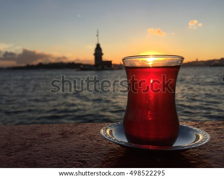 turkish tea against Maiden's Tower at sunset in Istanbul, Turkey