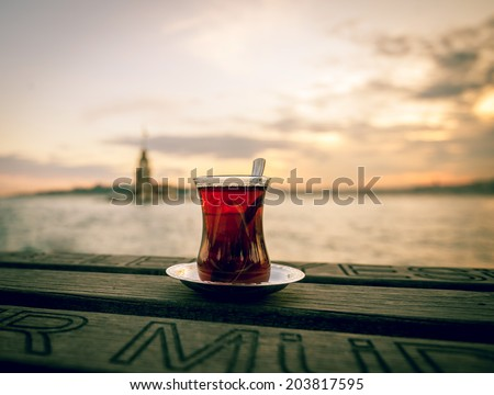 Turkish tea served at sitting places next to a Maiden's tower in Istanbul, Turkey - stock photo