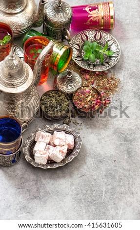 Turkish tea table with traditional delights. Ramadan kareem. Eid mubarak. Islamic holidays. Selective focus - stock photo
