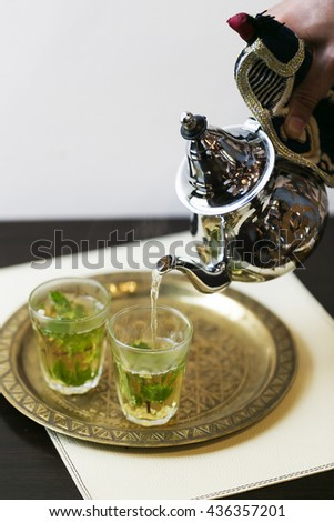 Turkish tea with authentic glass cup and metal tea kettle