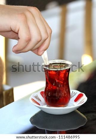 Turkish tea with traditional  tea glass - stock photo