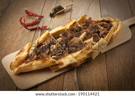 Turkish traditional beef Pide concept - stock photo