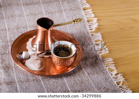 Turkish traditional coffee with cup and sugar on plate - stock photo