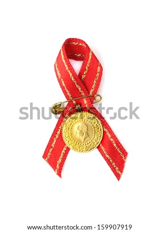 Turkish traditional gold coin with red ribbon. ( Quarter gold )  - stock photo