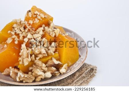 Turkish traditional Pumpkin Dessert ( kabak tatlisi ) isolated white background - stock photo