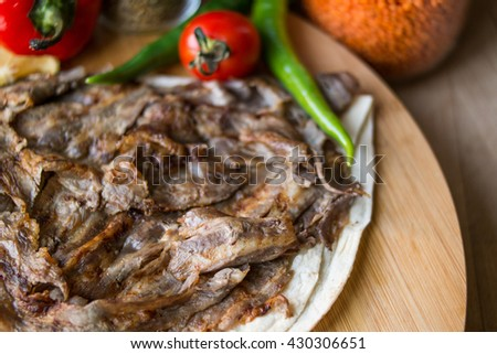 turkish traditional shawarma doner on a wooden surface at home in the kitchen close top view