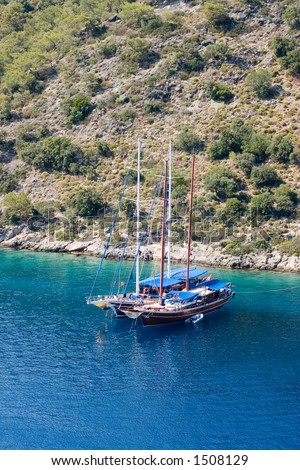 Turkish yachts at anchor in Gemiler Bay, near Fethiye - stock photo