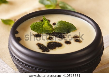Turkish Yayla soup with rice, mint and yoghurt in a bowl close-up on the table. horizontal