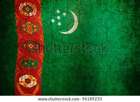 Turkmenistan flag on a cracked grunge background - stock photo