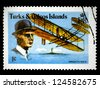 """TURKS AND CAICOS ISLANDS - CIRCA 1978: A stamp printed in Turks and Caicos Island shows a Wilbur Wright, with inscriptions """"Wright Flyer III"""", series """"75th Anniversary of Powered Flight"""", circa 1978. - stock photo"""