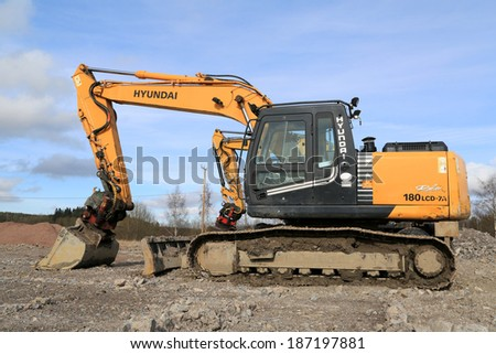 TURKU, FINLAND - APRIL 12, 2014: Hyundai Robex crawler excavator at construction site. The market share for Hyundai Heavy Industries Europe increased with more than 30% in 2013. - stock photo