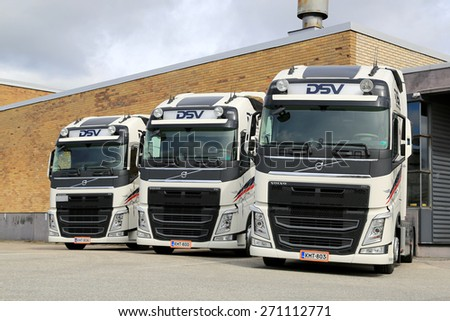 TURKU, FINLAND - APRIL 19, 2015: Three Volvo FH truck tractors of DSV parked. The Danish transport company DSV has offices in more than 70 countries including Finland. - stock photo