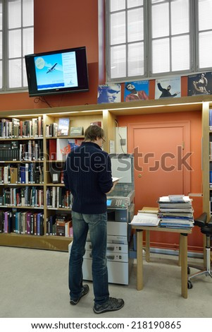 TURKU,FINLAND - AUGUST 27,2014:Turku City Library is municipal library service. It is open for everyone, their use is free of charge.Library collections include books,magazines,CDs,videotapes and DVDs - stock photo