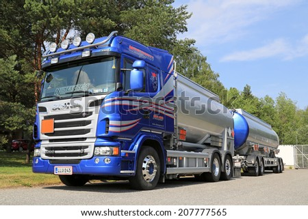 TURKU, FINLAND - JULY 13, 2014: Scania R500 V8 tank truck for chemical transport. European chemicals output will grow by 2.0% in 2014, according to Cefic, the European Chemical Industry Council. - stock photo